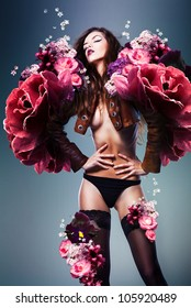 beautiful erotic sensual woman in jacket and panties with flowers