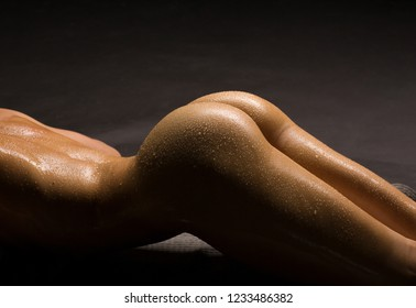 Beautiful erotic woman body part, naked butts, wet skin.
