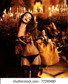 beautiful erotic woman with mask on venetian masquerade ball