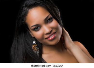 beautiful ethnic woman on black background