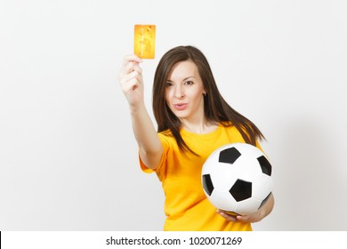 Beautiful European young cheerful woman, football fan or player in yellow uniform holding credit card soccer ball isolated on white background. Sport, play football game, excitement lifestyle concept