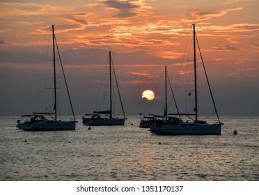 Beautiful evening Adriatic sea, yachts and sunset sky, Croatia. Evening seascape.