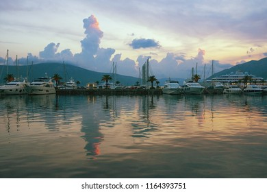 Beautiful evening landscape with yachts and its reflection in the water. Montenegro, Bay of Kotor (Adriatic Sea),Tivat, view of marina Porto Montenegro