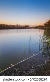 Beautiful evening on the coast of scenic calm lake
