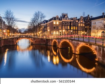 Beautiful evening scene of Amsterdam canals Keizersgracht and Leidsegracht in the evening with illuminated bridges and streets