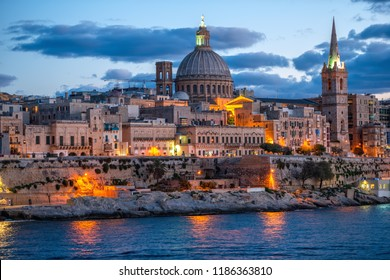 beautiful evening scene of Basilica Our Lady Mount Carmel in Valletta from Sliema, Malta, close up
