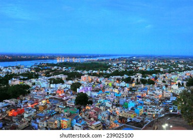 Beautiful evening scene of Trichy (Tiruchirapalli) city and Kaveri river with a bridge - view from ancient Rock Fort (Rockfort) and Hindu temple, Tamil Nadu state, India, South Asia