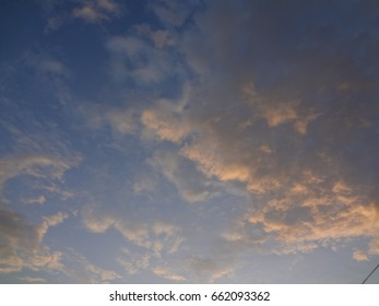 A beautiful evening sky full of fluffy white clouds.