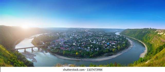 Beautiful evening summer panoramic view of Zalishchyky or Zalischiki, evening view of the town on the bank of the Dniester River meander around city. The province of Bukovina. Ternopil region. Ukraine