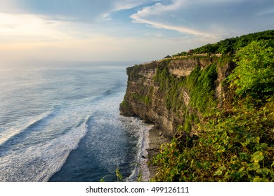 Beautiful evening of Uluwatu Temple cliff with pavilion and blue sea in Bali, Indonesia