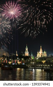Beautiful evening view of the Moscow Kremlin and the holiday fireworks in the sky over Red Square, Russia
