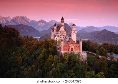 Beautiful evening view of the Neuschwanstein castle, with autumn colors after sunset, Bavarian Alps in Bavaria, Germany.