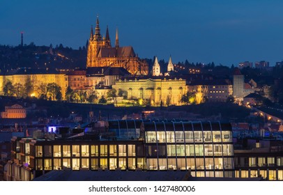 Beautiful evening view on Prague Castle and modern corporate bui
