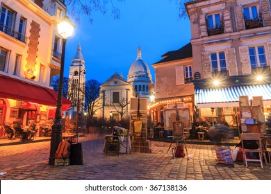 Beautiful evening view of the Place du Tertre and the Sacre-Coeur in Paris, France