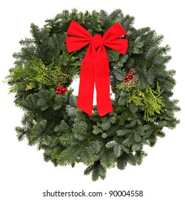Beautiful evergreen Christmas wreath with red bow, isolated