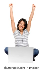 Beautiful excited girl with a laptop isolated on white