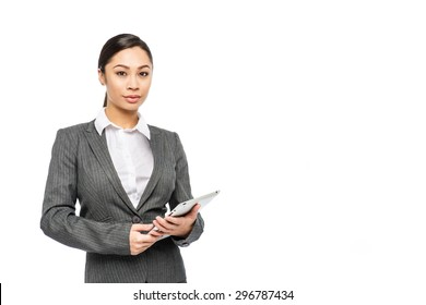 Beautiful executive asian woman in smart suit. Studio shot on white background.