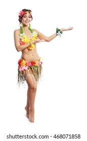 Beautiful exotic girl with Hawaiian accessories inviting and smiling
