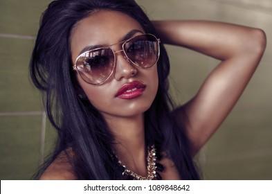 Beautiful exotic woman wearing sunglasses