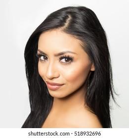 Beautiful exotic young woman - dark brunette hair