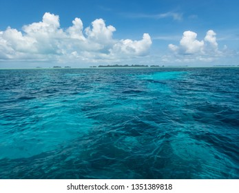Beautiful expanse of turquoise tropical sea and white puffy clouds complete picture of tropical paradise