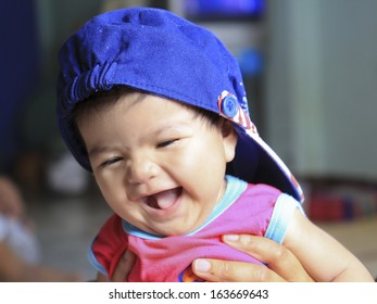 Beautiful expressive adorable happy cute laughing smiling baby.