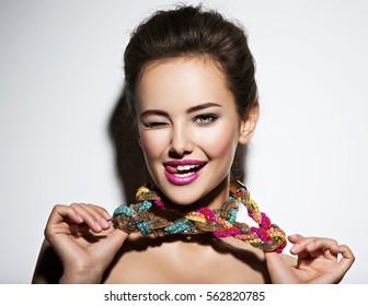 beautiful expressive woman with bright  jewelry and beauty fashion photo