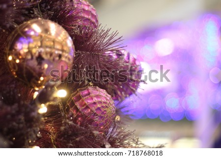 beautiful and exquisite purple pink and gold christmas ornaments wallpaper background soft focus