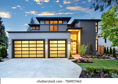 Beautiful exterior of contemporary home with two car garage spaces at sunset. Northwest, USA