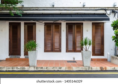 A beautiful exterior view of an restaurant with timber window and door.