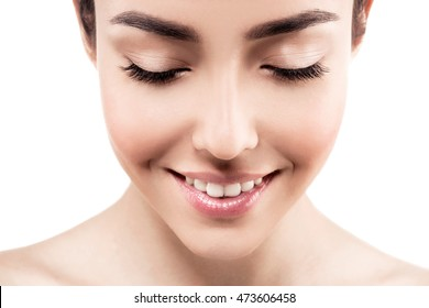 Beautiful eyes lashes closeup closed. Beauty Woman face Portrait. Beautiful model Girl with Perfect Fresh Clean Skin and healthy white teeth. Youth and Skin Care Concept. Isolated on white background