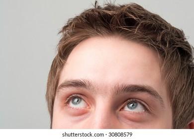 Beautiful eyes. The man looks up optimistic.