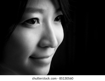 Beautiful eyes and sweet smile of Asian young woman