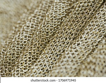 beautiful fabric in the form of a gold mesh that looks like chain mail