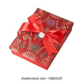 A  beautiful fabric gift box with red ribbon