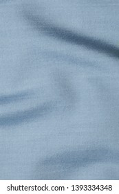 Beautiful fabric, texture of a blue gray plain fabric, mock-up, for men's suit