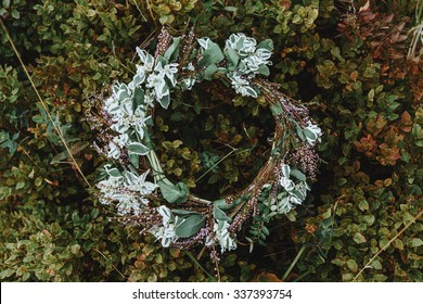 beautiful fabulous boho rustic wedding wreath for a bride on the background of grass in the mountains