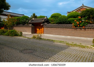 Beautiful facade traditional korean house in old village. Main door entrance with trees in background. Jeonju city, South Korea
