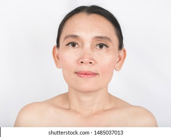 Beautiful face 50 age and good skin health on white