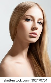 Beautiful face of blond woman with long healthy and shiny hair