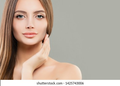 Beautiful face closeup. Healthy model woman with clear skin and healthy hair. Skincare and facial treatment concept