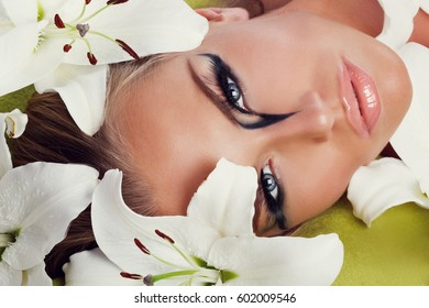 Beautiful face close-up in lilies