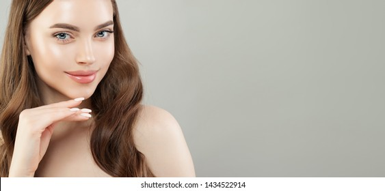Beautiful face closeup portrait. Pretty woman smiling on gray banner background