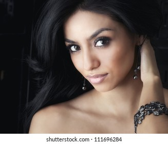 beautiful face of dark haired woman.