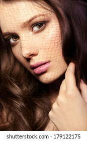 Beautiful face of a glamour woman with smoky eyes make up. Close-up beauty portrait of young beautiful woman.