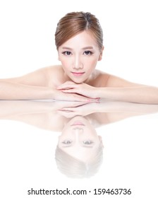 Beautiful face skincare beauty woman lying down with mirror reflection isolated on white background. asian beauty model