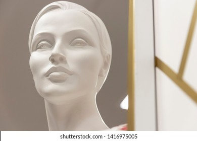 Beautiful face of white mannequin woman with short haircut in department store