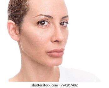 Beautiful face of woman with fresh healthy skin. Isolated closeup portrait on white background.