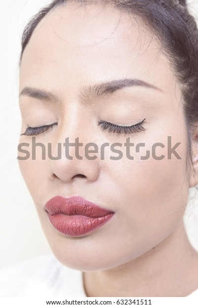 Beautiful face woman with red lips, gray eyes and black hair.