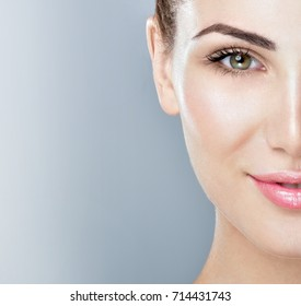Beautiful face of young adult woman with clean fresh skin.